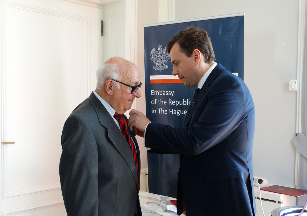 President Meron receives Award from Chargé d'affaires, Mr Piotr Kobza at the Polish Embassy in The Hague