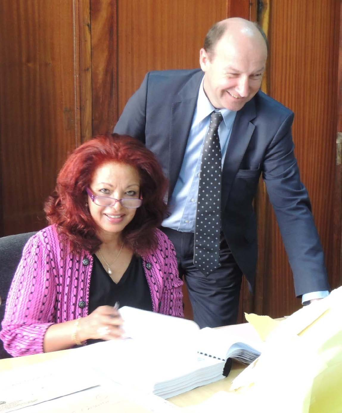 Halima Mohamed, Chairperson of the Tender Opening Committee, with MICT Registrar John Hocking