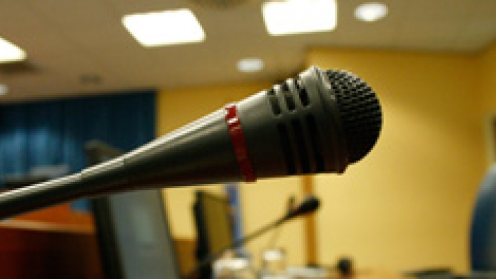 Image of witness stand with a microphone
